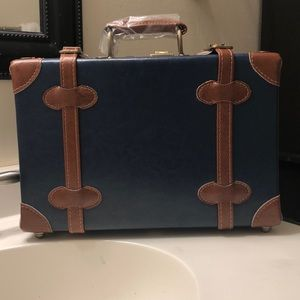 Train case with tan leather accents